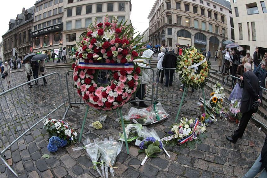 Wreaths placed outside Rouen's cathedral on August 2, 2016, following the funeral of a priest who was killed in Saint-Etienne-du-Rouvray on July 26.