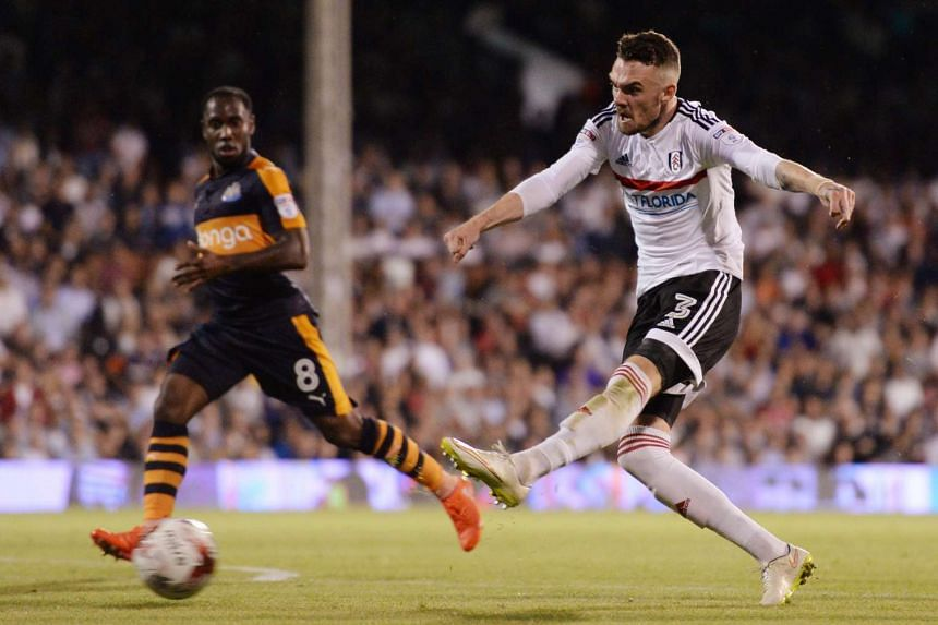 Fulham's Scott Malone takes a shot at the goal during a match against Newcastle on Aug 5, 2016.