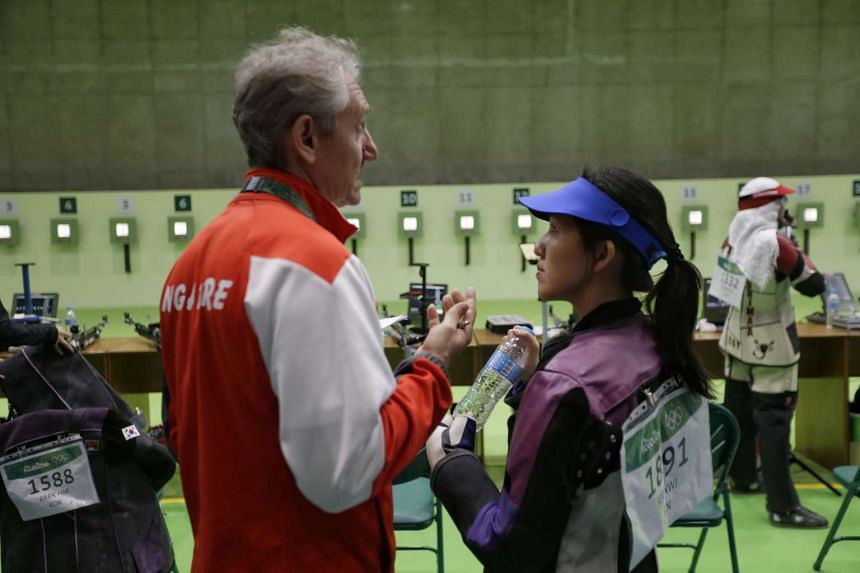 Shooter Jasmine Ser of Singapore speaking to her coach Kirill Ivanov after the Rio2016 Olympic Games women's 10m air rifle event on Aug 6, 2016.