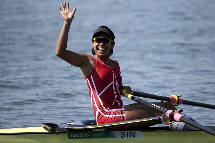 National rower Saiyidah Aisyah waves after clocked 8:44.71 in Heat 4 of the women's single sculls race on Aug 6, 2016.