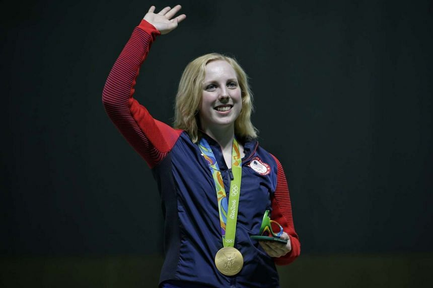 Virginia Thrasher of the USA waves after winning the gold medal for the Rio 2016 Olympic Games women's 10m air rifle finals on Aug 6, 2016.
