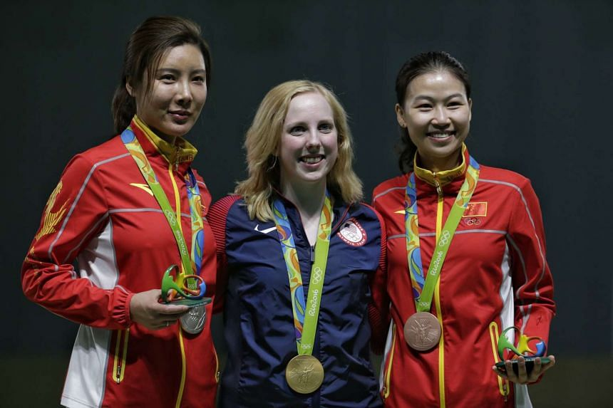 (Left to right) Silver medalist Du Li of China, gold medalist Virginia Thrasher of the USA, and bronze medalist Yi Siling of China on the podium for the Rio 2016 Olympic Games women's 10m air rifle finals on Aug 6, 2016.