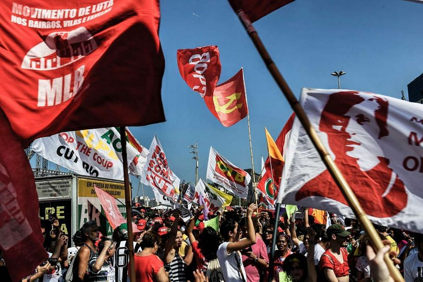 People demonstrate against the Rio 2016 Olympic Games and interim President Michel Temer in Rio de Janeiro on Aug 4, 2016.