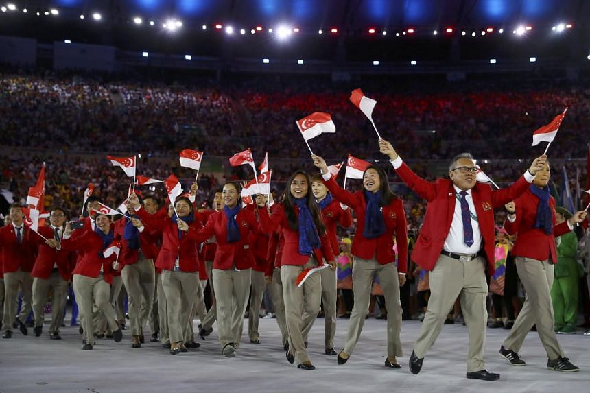 Singapore athletes take part in the opening ceremony.