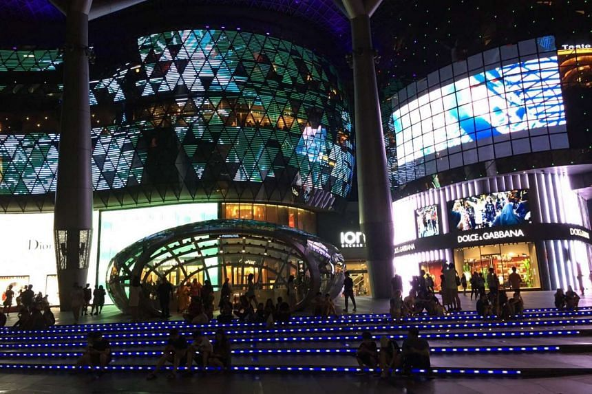 Groups of Pokemon Go players gather outside Ion Orchard to play the mobile game. The mall is releasing lures until Aug 21, which attract more Pokemon to the vicinity.