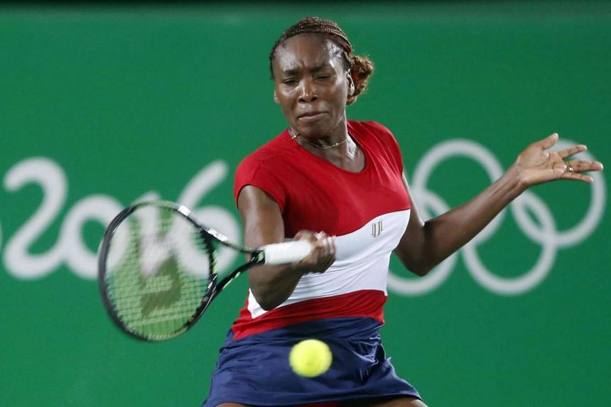 Venus Williams of the USA returns to Kirsten Flipkens of Belgium during the women's singles 1st round match of the Rio 2016 Olympic Games Tennis events at the Olympic Tennis Centre in the Olympic Park in Rio de Janeiro, Brazil on August 6.