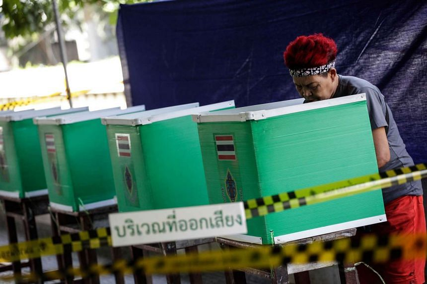 A Thai woman votes during Thailand's constitutional referendum in Bangkok on Aug 7, 2016.