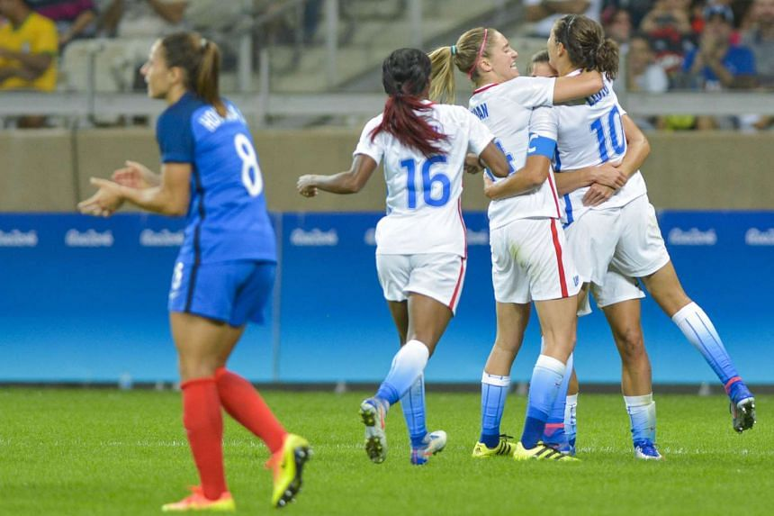 Carli Lloyd of USA (right) is celebrated by teammates for scoring the 1-0 goal during the women's preliminary round group G match between USA and France of the Rio 2016 Olympic Games on Aug 8, 2016.