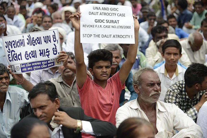 Protesters rallying in Ahmedabad on July 31 against the vigilante attack on four Dalit youths caught skinning a dead cow in Una, Gujarat. On social media, activists have been urging Dalits to take a solemn pledge to refuse to do some of their traditi