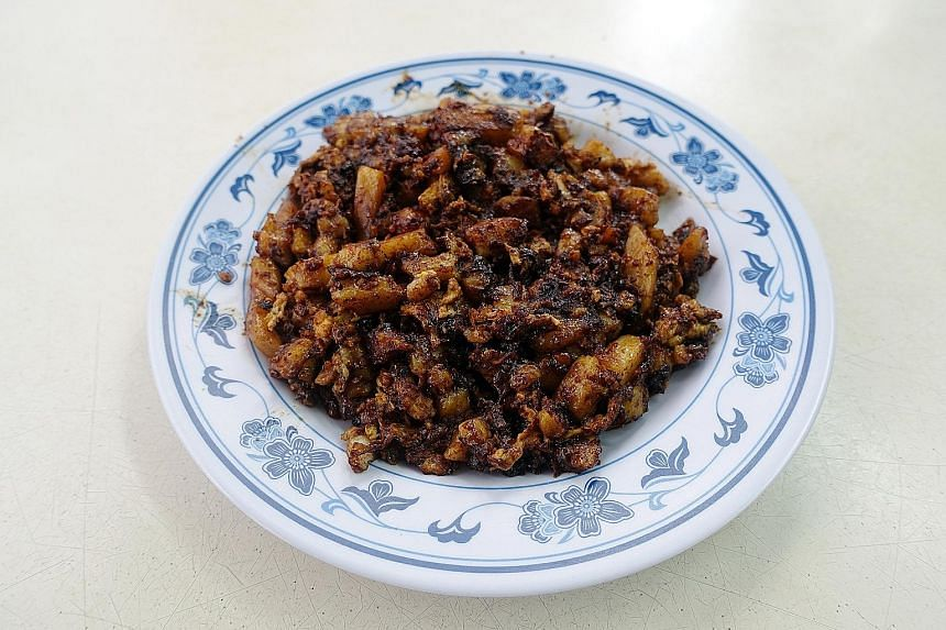 Potong Pasir King Specialist Carrot Cake's black chye tow kueh (above). It offers the white version too.