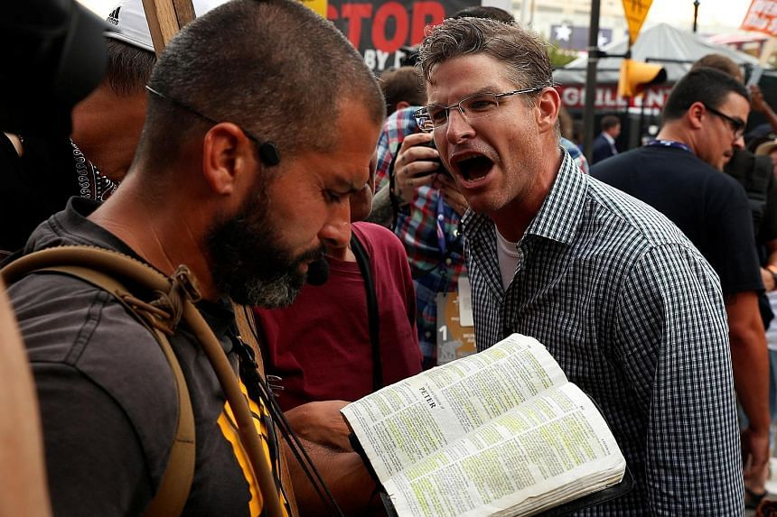 A Trump protester showing his displeasure at a man reciting religious scripture outside the Republican National Convention in Cleveland, Ohio, last month.