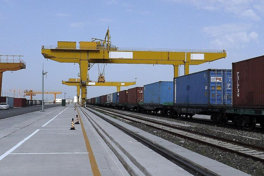 Freight trains entering China from Kazakhstan stop at the Horgas railway port to allow the containers to be transferred to local trains, which make the onward journey into the mainland. Horgas has invested US$100 million (S$135 million) to build a ne