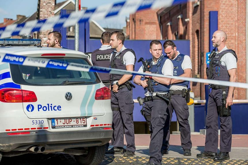 Belgian police officers oversee the scene of the attack in Charleroi, Belgium.