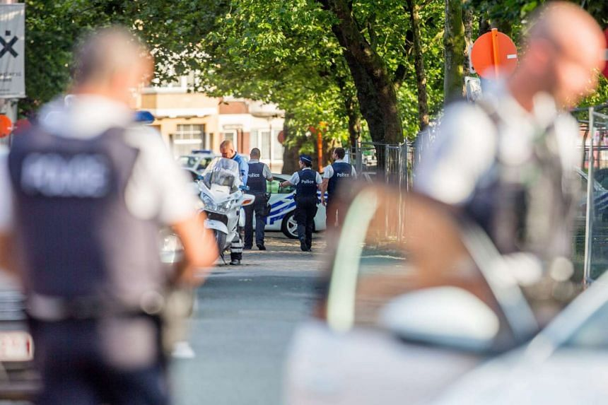 Police officers patrol the scene of the attack in Charleroi, Belgium.