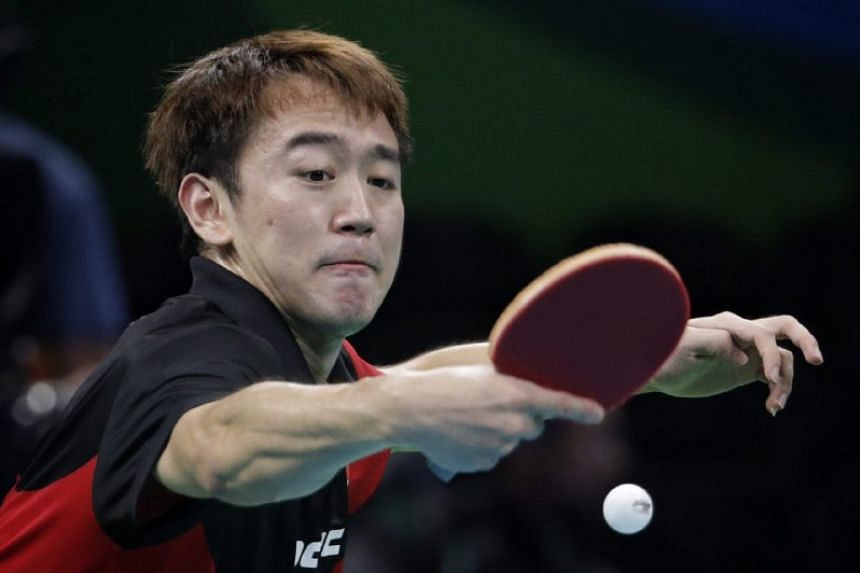 Chen in action against Finland's Benedek Olah. Chen said the nerves of playing his first Olympics got the better of him.