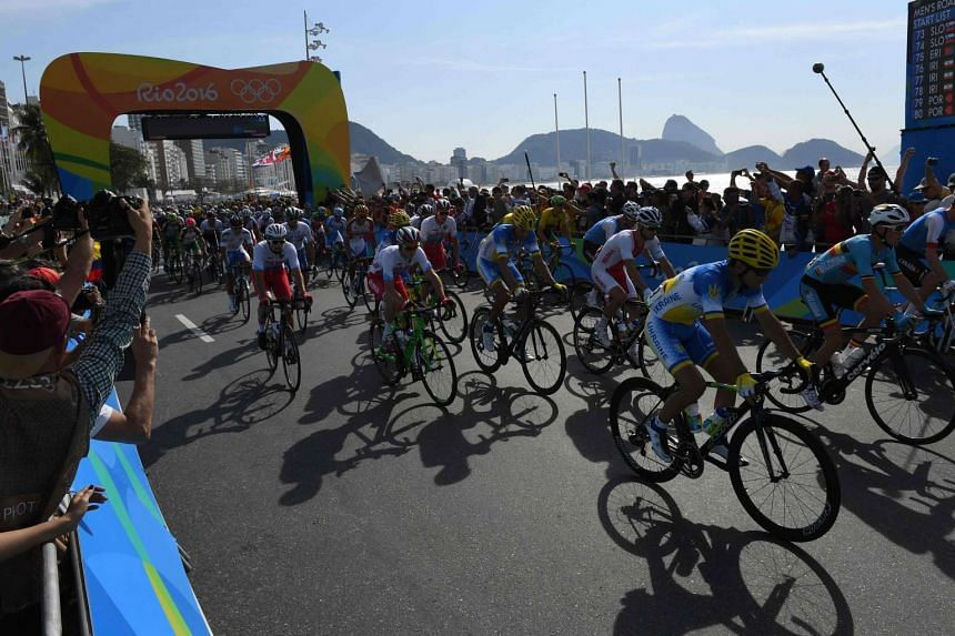 Competitors start the Men's Road cycling race in the Rio 2016 Olympic Games in Rio de Janeiro on Aug 6, 2016.