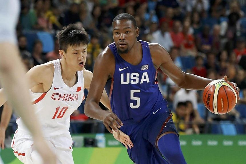 Zhou Peng of China and Kevin Durant of the US compete during the Group A basketball match between China and US, on August 6.