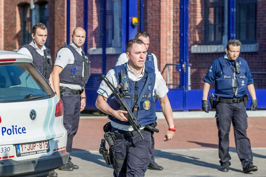 Belgian police officers securing the area where two policewomen were attacked with machetes in Charleroi, Belgium, on Aug 6, 2016.
