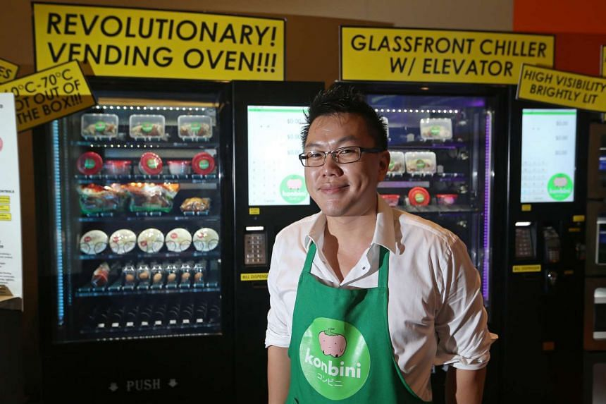 Mr Jing Quek, founder of Konbini, with his vending oven, which maintains a temperature of 60 to 70 deg C allowing it to slow cook food, at the VendTech Singapore exhibition on Aug 2, 2016.