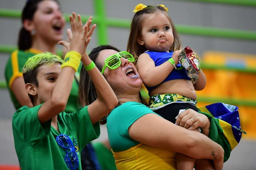 Brazilian fans cheer as they await a handball match between Norway and Brazil on Aug 6, 2016.