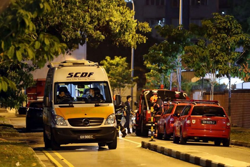 SCDF vehicles parked outside the building.