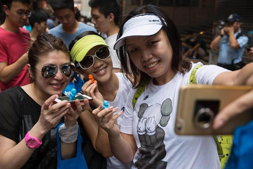 Participants take a selfie during the PokeWalk in Hong Kong.