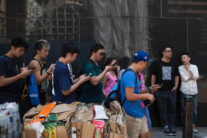 Participants use their smartphones as they play Pokemon Go on the walk.