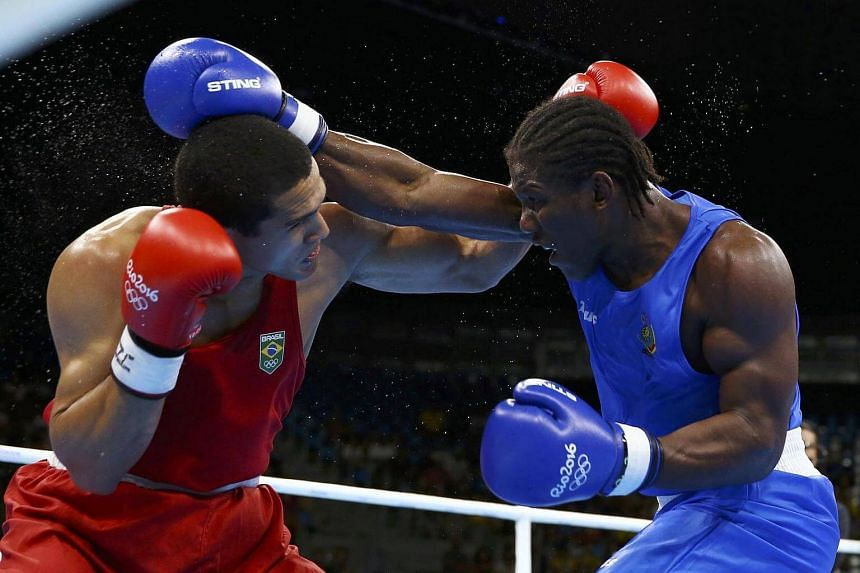Michel Borges of Brazil and Hassan N'Dam N'Jikam of Cameroon compete during the Men's Light Heavy (81kg) match at the Rio 2016 Olympic Games on August 6.