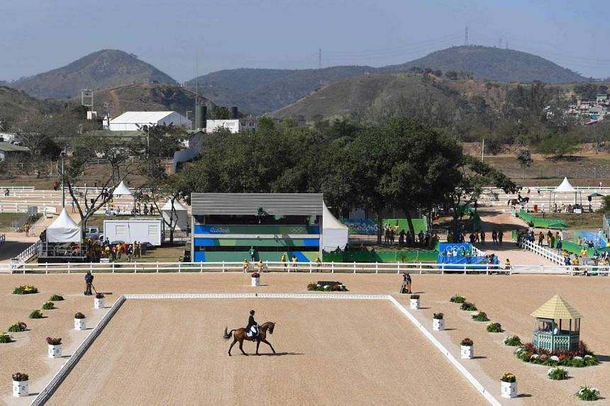 A competitor performs his dressage routine at the Olympic Equestrian Centre on Aug 6, 2016.