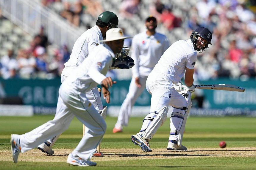 England's James Vince (right) plays a shot during the fourth day of the third test cricket match between England and Pakistan on August 6.