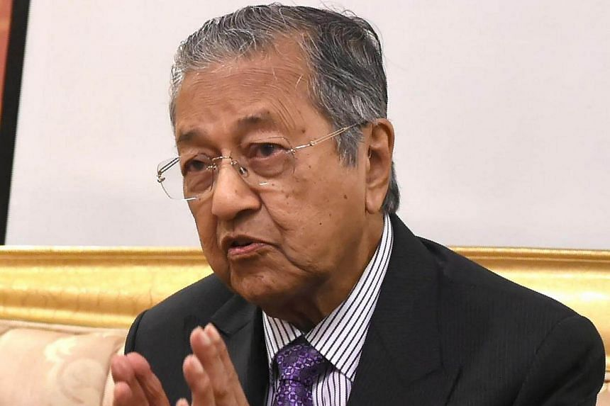 Former Malaysian prime minister Mahathir Mohamad talks to the media during a visit to Jakarta on July 25.