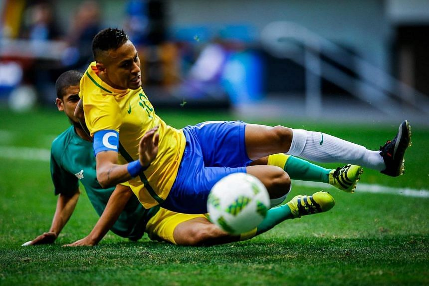 Neymar of Brazil (front) is tackled by Abbubaker Mobara of South Africa during the men's preliminary round match between Brazil and South Africa for the Rio 2016 Olympic Games Soccer tournament in Brasilia, Brazil, on August 4.