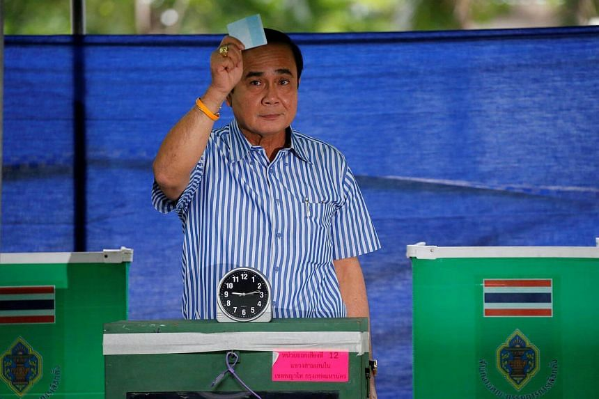 Thai Prime Minister Prayuth Chan-ocha casts his ballot at a polling station during a constitutional referendum vote in Bangkok, Thailand on August 7.