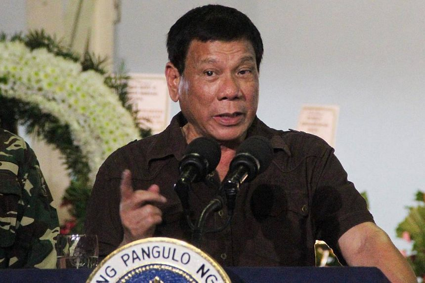 Filipino President Rodrigo Duterte speaks during a visit at the wake of killed soldiers in Davao city, southern Philippines on August 7.