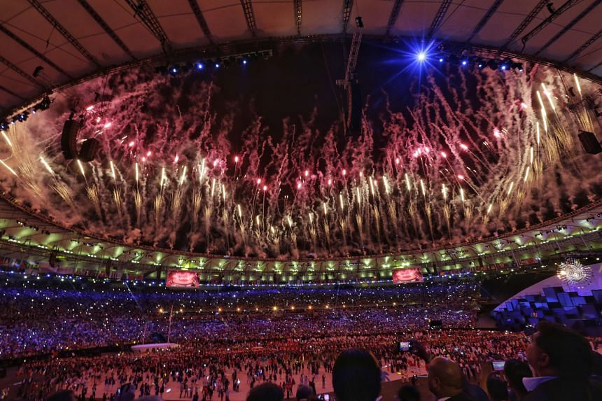 """AN EXPERIENCE TO SAVOUR: """"It was an exhilarating moment walking into the packed stadium carrying our Singapore flag high and proud."""" - DEREK WONG, Singapore flag-bearer, on what the honour meant to him."""