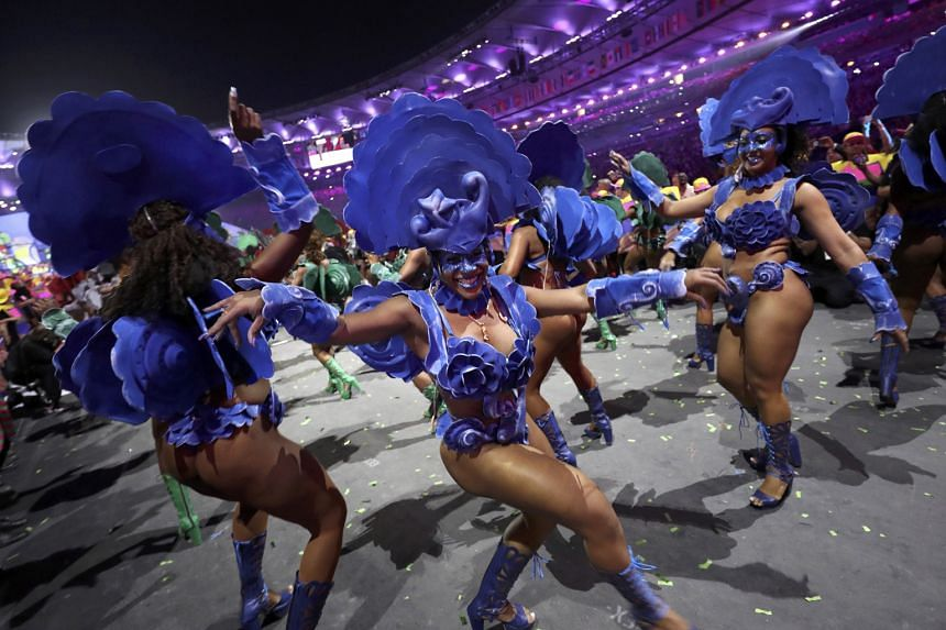 Samba dancers celebrate the country's traditional connection with music and dance.