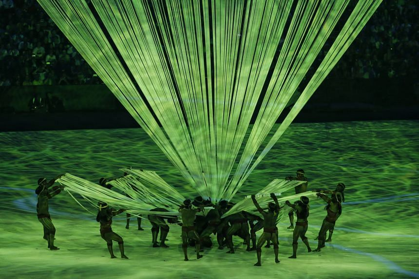 Performers created striking geometrical shapes using lighted strings.