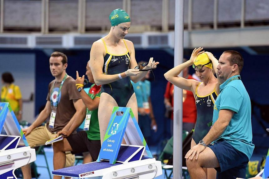 Australian swimmers Cate (second, left) and Bronte Campbell (second, right) are seen with coach Simon Cusack (right) during the team's first training session at the Rio Olympic Games Aquatics Centre in Rio de Janeiro, Brazil on August 1.