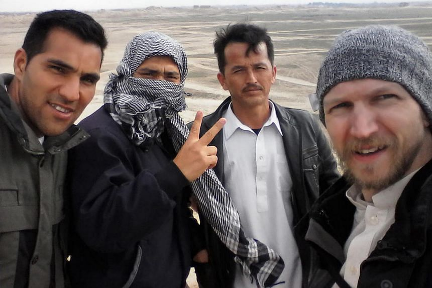 This photograph received from Irish tourist Jonny Blair on August 6 shows Jonny Blair (right) with three Afghan men during his travels in Afghanistan.