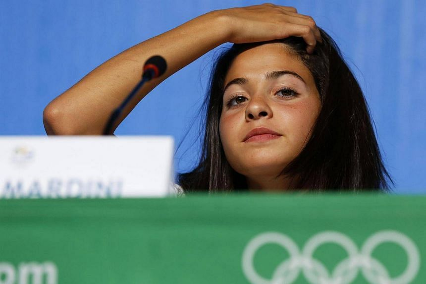 Syrian swimmer Yusra Mardini attends a press conference for the Olympic refugee team on July 30, 2016.