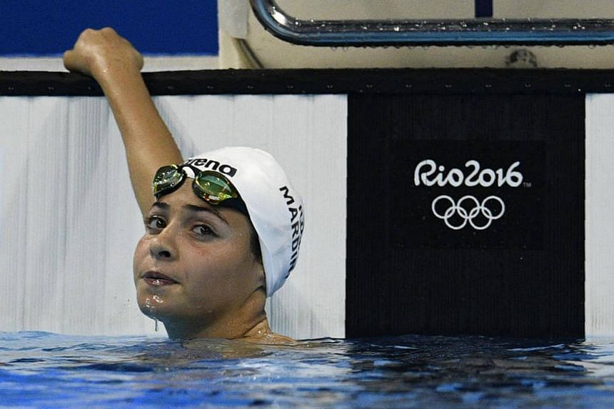 Mardini takes part in the women's 100m butterfly heat on Aug 6, 2016.