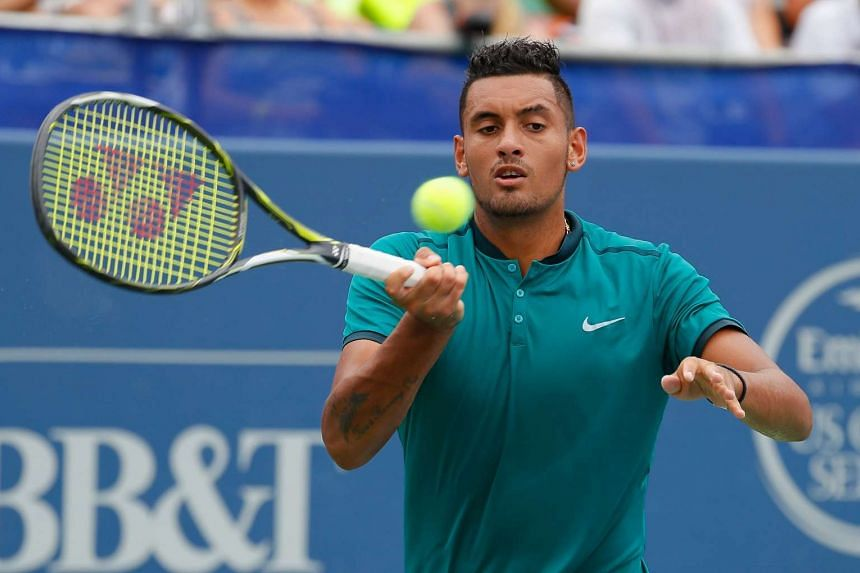 Nick Kyrgios of Australia returns a forehand to John Isner during the finals of the BB&T Atlanta Open at Atlantic Station on Aug 7, 2016.
