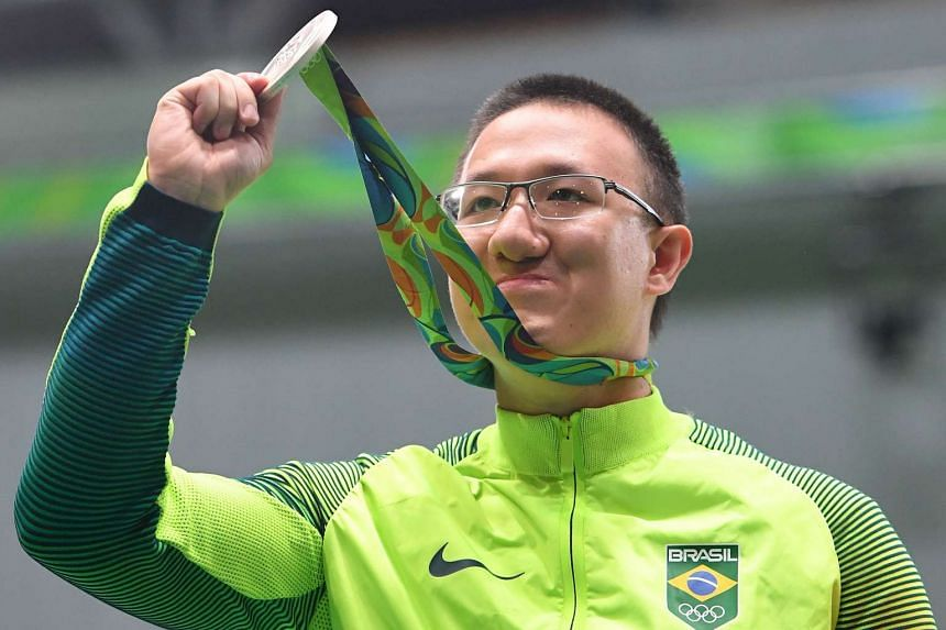 Brazil's Felipe Almeida Wu poses on the podium at the medal ceremony for the men's 10m air pistol shooting event at the Olympic Shooting Centre, on Aug 6, 2016.