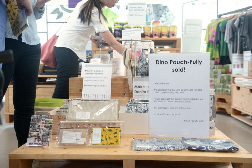 A sign telling customers that the dinosaur pouch designed by Pathlight student Seetoh Sheng Jie has been sold out, at the school on Aug 4, 2016.