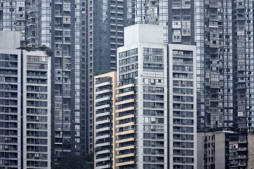 Residential buildings stand in Chongqing, China, on April 12, 2016.