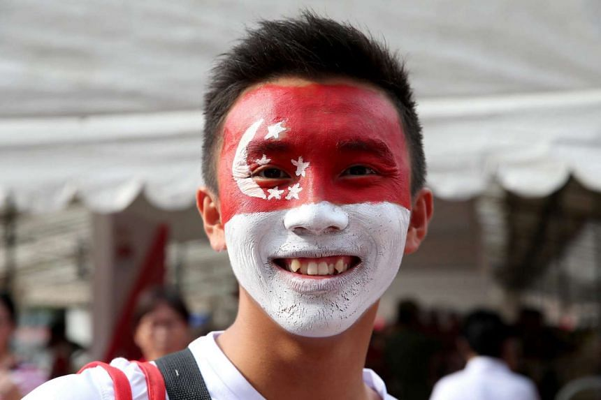 A spectator attending the National Day Parade 2015 held at the Padang had the Singapore flag painted on his face.