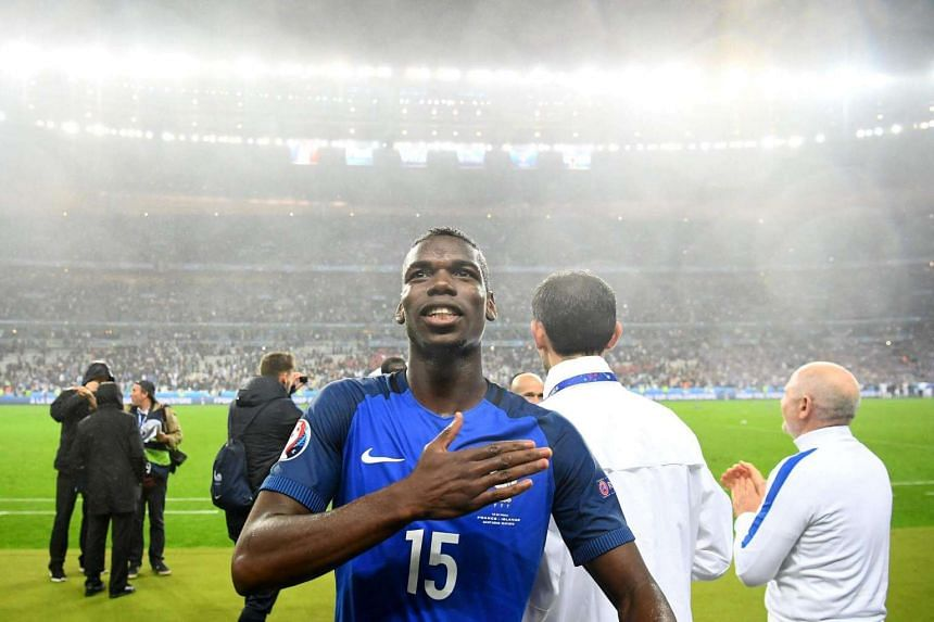 France's midfielder Paul Pogba during the Euro 2016 quarter-final football match between France and Iceland at the Stade de France in Saint-Denis on July 3.
