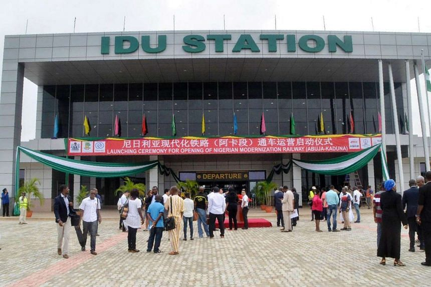 People stand outside the Idu train station in Abuja, Nigeria, on July 21.