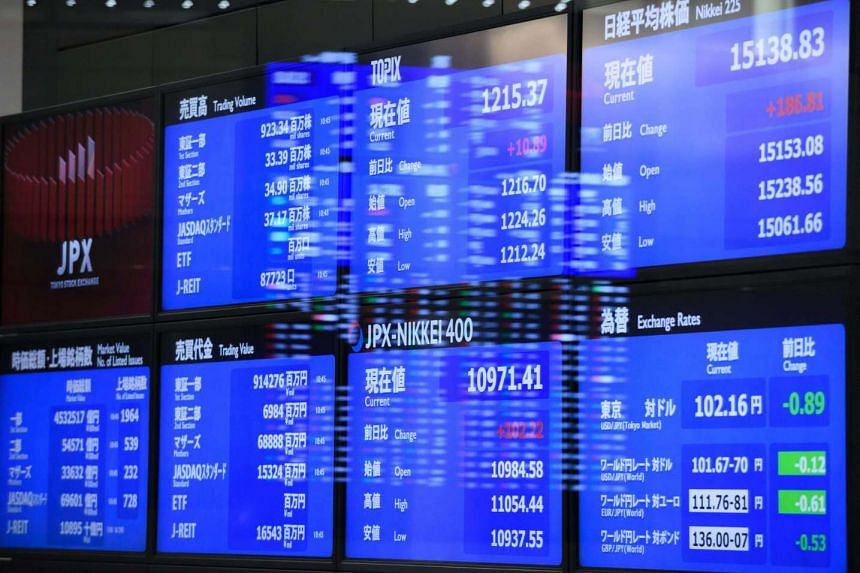 Electronic boards display market indices at the Tokyo Stock Exchange on June 27.