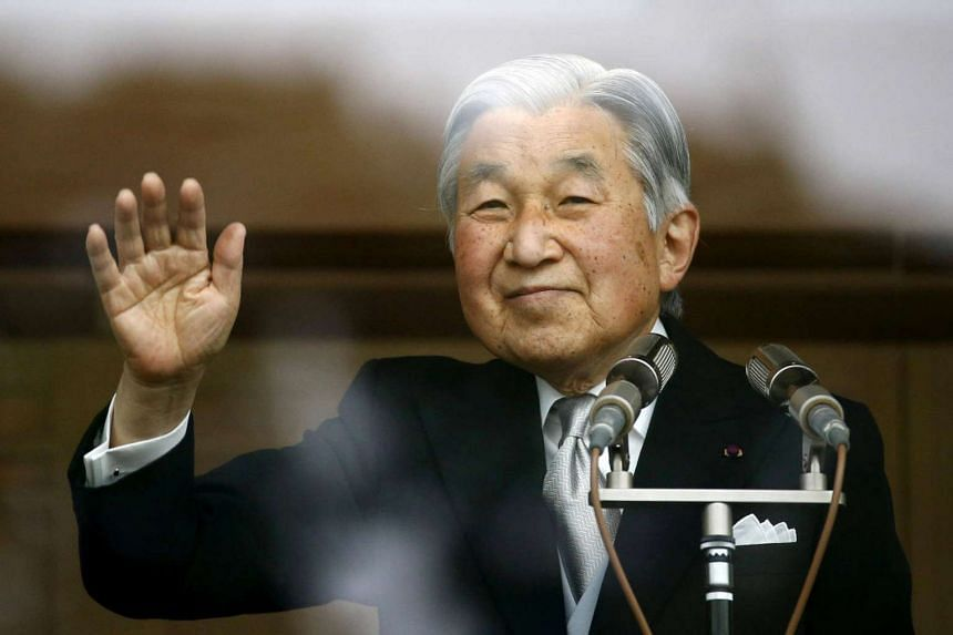 Japan's Emperor Akihito waves to well-wishers who gathered at the Imperial Palace to mark his 82nd birthday in Tokyo, Japan, Dec 23, 2015.